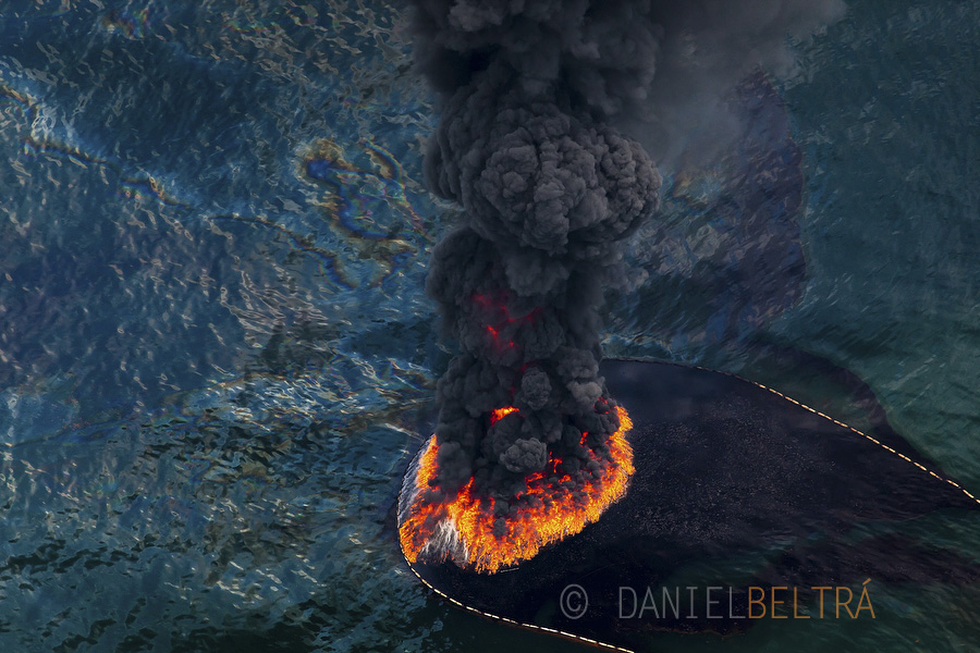 A plume of smoke rises from a burn of collected oil. A total of 411 controlled burns were used to try rid the Gulf of the most visible surface oil from the BP Deepwater Horizon wellhead.